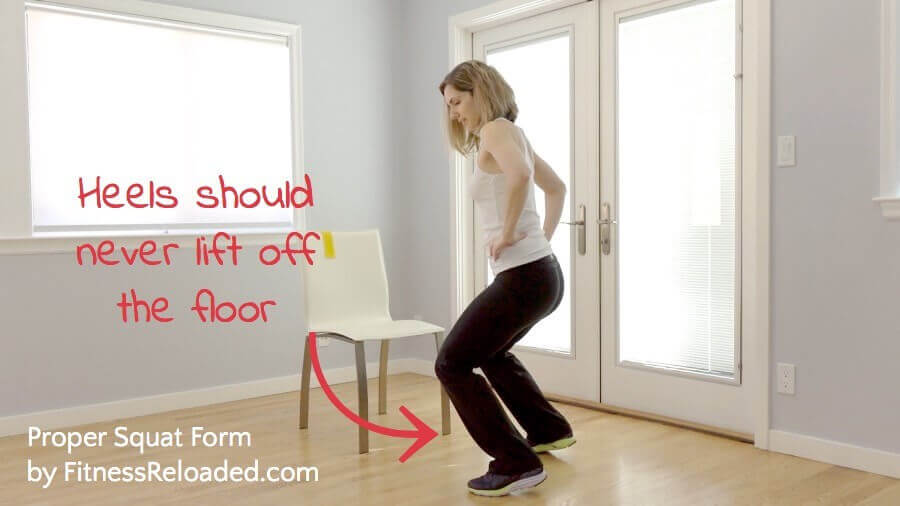 proper squat form Heels should never lift off the floor